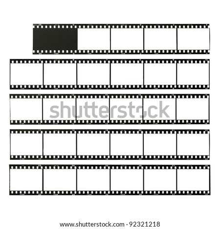 35 mm format film strips cut for test, isolated on white - stock photo