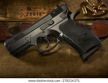 9mm gun on suitcase - stock photo