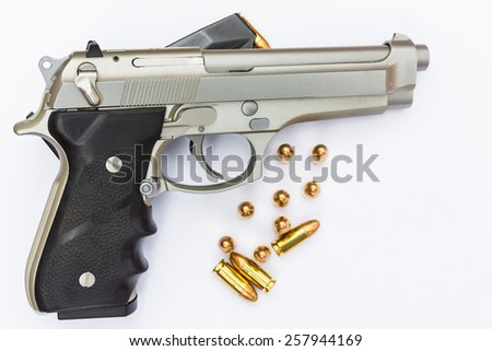 9 mm gun with ammunition background is white - stock photo