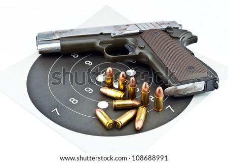 9-mm handgun and target shooting - stock photo