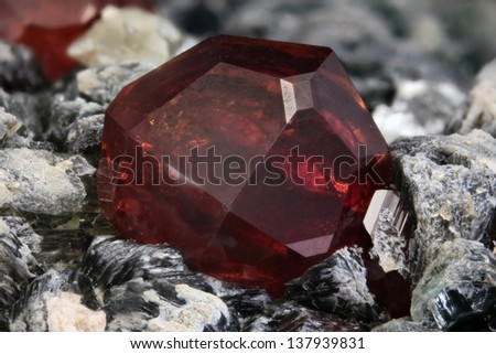 4.84 mm Hessonite crystal from Bellecombe, Aosta valley, Italy - stock photo