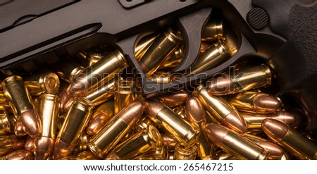 9mm Luger bullets with handgun - stock photo