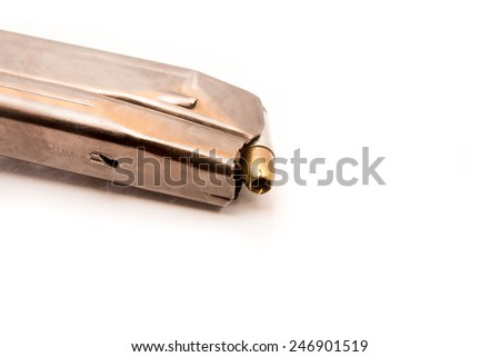 9mm magazine with bullets isolated on white - stock photo