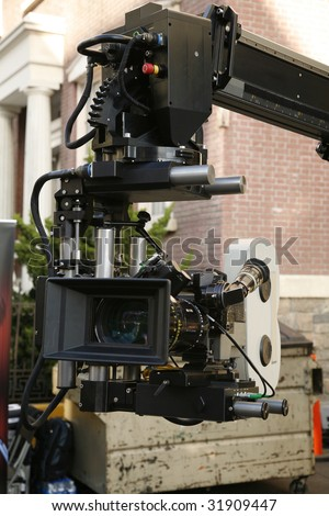 35 mm motion picture film camera with mounted on robotic crane on location - stock photo