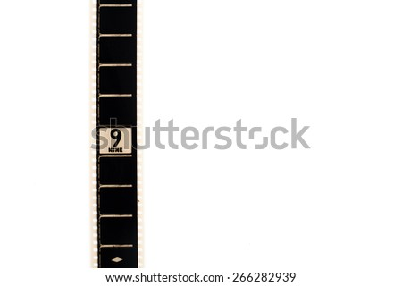 35mm movie film with number nine frame countdown, vertical and copyspace isolated on white background - stock photo