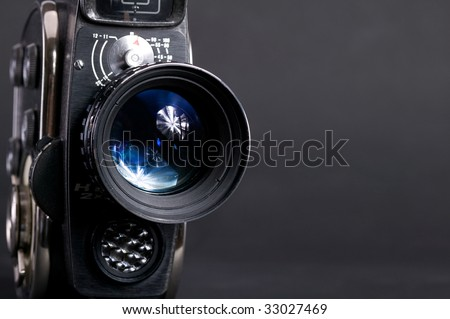 8mm old cinema camera on gray background - stock photo