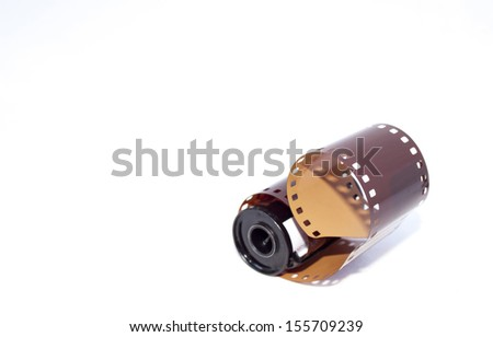35mm photographic film extending from casing - stock photo