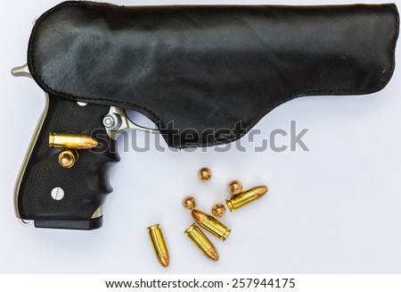 9 mm pistol ammunition the backdrop is a white paper - stock photo