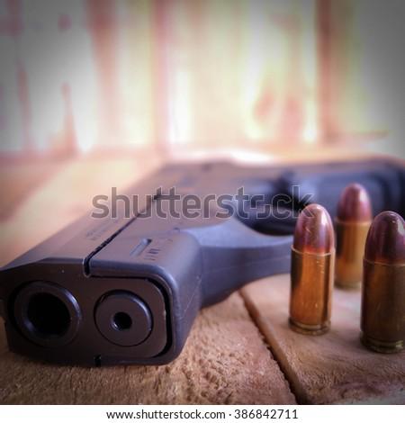 9 mm pistol  and  gun - stock photo