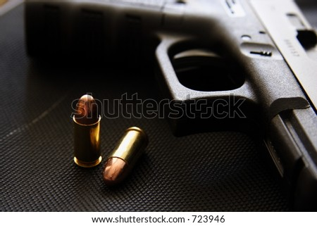 9mm pistol & bullets - stock photo