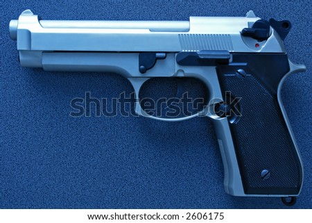 9mm plastic grip handgun - stock photo