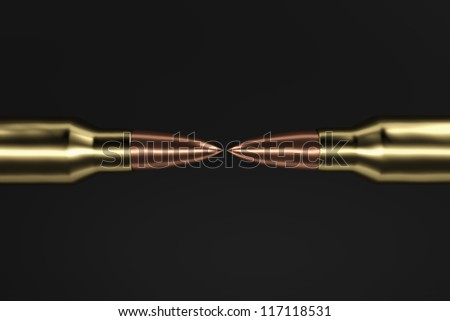 5.56 mm rifle bullets facing each other. - stock photo