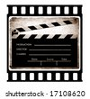 35mm slide frame with film clapboard - stock photo