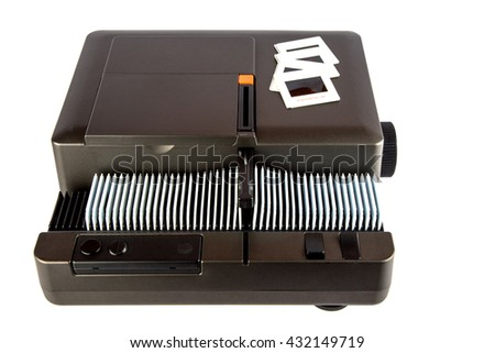 35mm slide projector with magazine and slides isolated on white