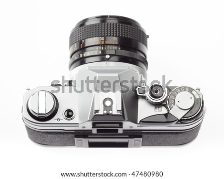 35mm SLR camera, seen from above, on a white background - stock photo