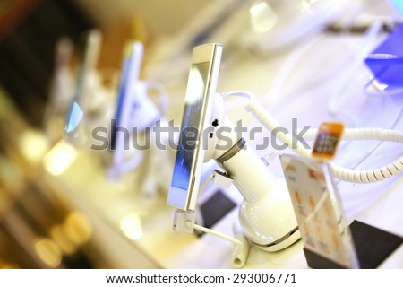 mobile phone in shop, electronics internet and communication network service business, Digital gadget and phone in electronic store. - stock photo