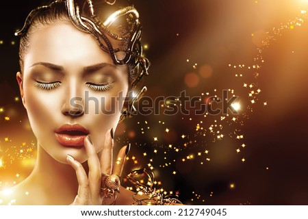 Model Girl face with gold skin, nails, make-up and accessories. Fashion Magic Woman with holiday golden makeup - stock photo