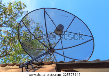 modern analog satellite on the roof  - stock photo