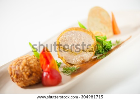 3 modern cuisine Prosciutto Wrapped Chicken with resotto and tamarind sauce, Fried mussaman curry, and Thai chicken spicy sausage on ceramic dish garnished with vegetables