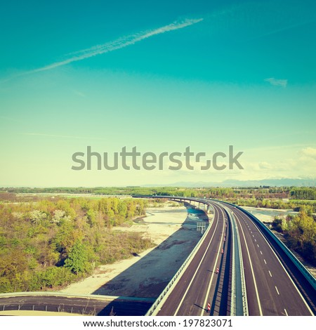 Modern Highway in Italy on the Background of Snow-capped Alps, Retro Effect