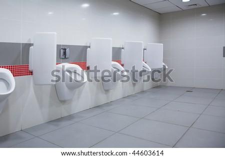 modern restroom interior photo with urinal row - stock photo