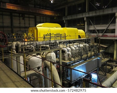 24.10.2016, Moldova, Chisinau: Steam turbine during repair, machinery, pipes, tubes at a power plant, night scene