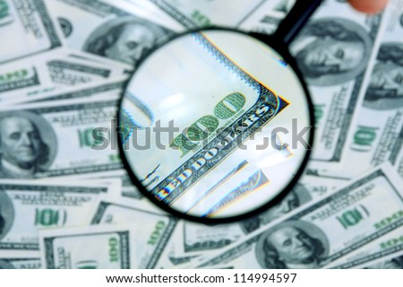 Money and magnifying glass