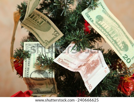 money as christmas tree decoration as a symbol of prosperity and luck in new 2015  - stock photo