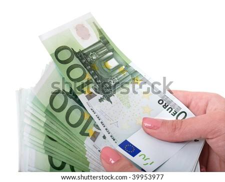 Money euro in female hand. Isolated. - stock photo