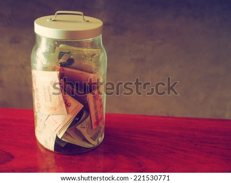 money in bottle vintage color tone  - stock photo