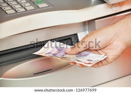 Money taken from ATM - Chinese renminbi yuan banknotes - stock photo