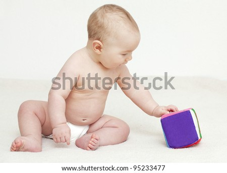 7 month baby playing with a cube