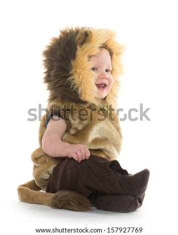18-month-old baby boy in a lion costume for Halloween on white background - stock photo