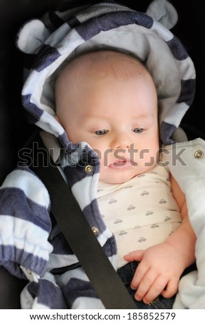 3 month old baby boy in car seat - stock photo