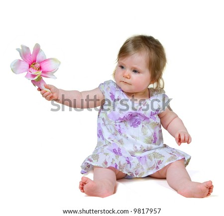 9 month old baby girl in summer dress holding flower isolated on white - stock photo