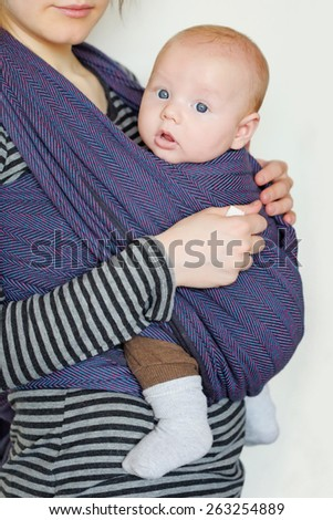 3 month old baby in sling - stock photo