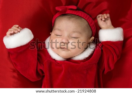 3 month old baby sleeping with her Christmas dress