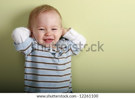14 month old smiles a toothy grin - stock photo