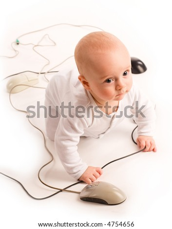 7 months baby playing with computer mouses - stock photo