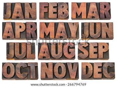 12 months from January to December - a collage of isolated 3 letter symbols in vintage letterpress wood type blocks - stock photo