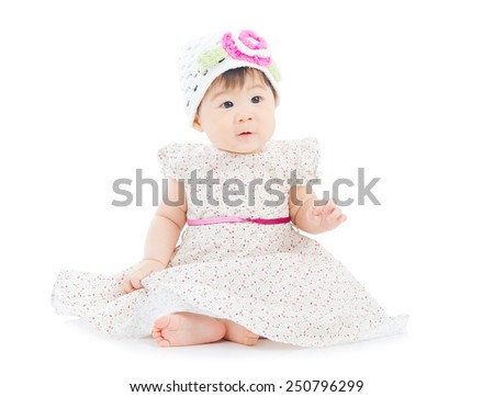6 months old asian baby sitting on the floor - stock photo