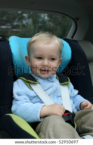 18 months old baby boy in car safety seat. - stock photo