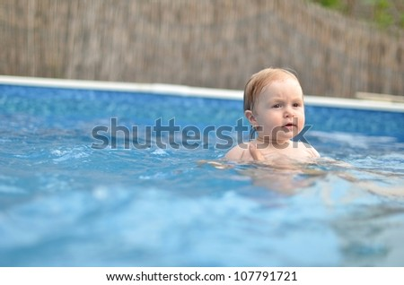 7 months old baby swimming in pool