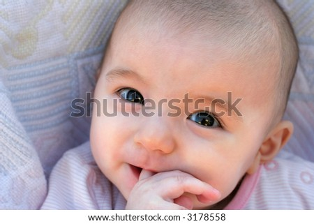 4 Months Old cute baby girl smiling - stock photo