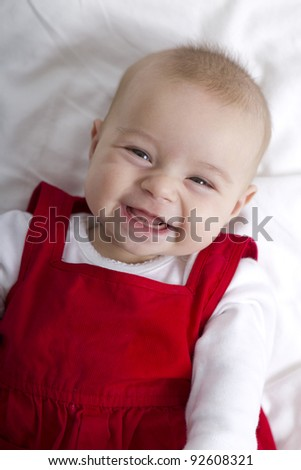 3 Months old girl smiling with no fear, waiting her teeth and hair to grow. - stock photo