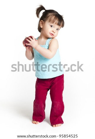 18 months old toddler holding an apple - stock photo