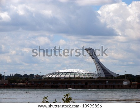 Montreal Olympic stadium  and Saint-Lawrence river - stock photo