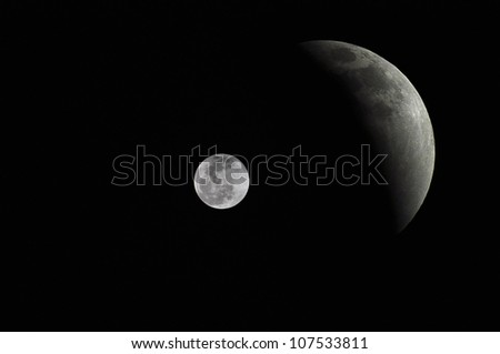 2 moons  on black space - stock photo