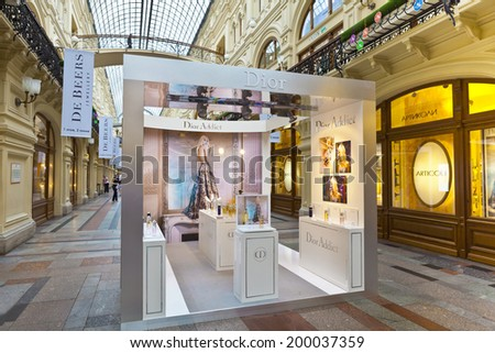 MOSCOW - JUNE 9, 2014: Luxury shops inside famous GUM the large store in the Kitai-gorod part of Moscow facing Red Square. It is currently a shopping mall. - stock photo