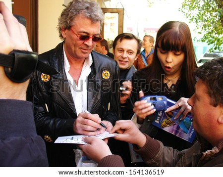 "MOSCOW - OCTOBER 13: Ian Gillan signs autographs as he arrives at the presentation of new Deep Purple ""Rapture of the deep"" album on October 13, 2005 in Moscow."